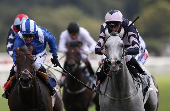 Lord Glitters ridden by Daniel Tudhope (right) wins the Sky Bet And Symphony Group Strensall Stakes at York last year