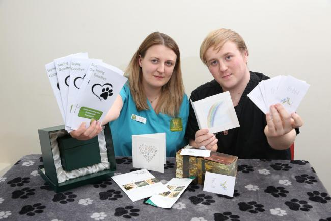 Wilson Vets clinical director Jenni Long and veterinary nurse Tom Gash with sympathy cards and Forget-me-Not seeds they give to bereaved pet owners