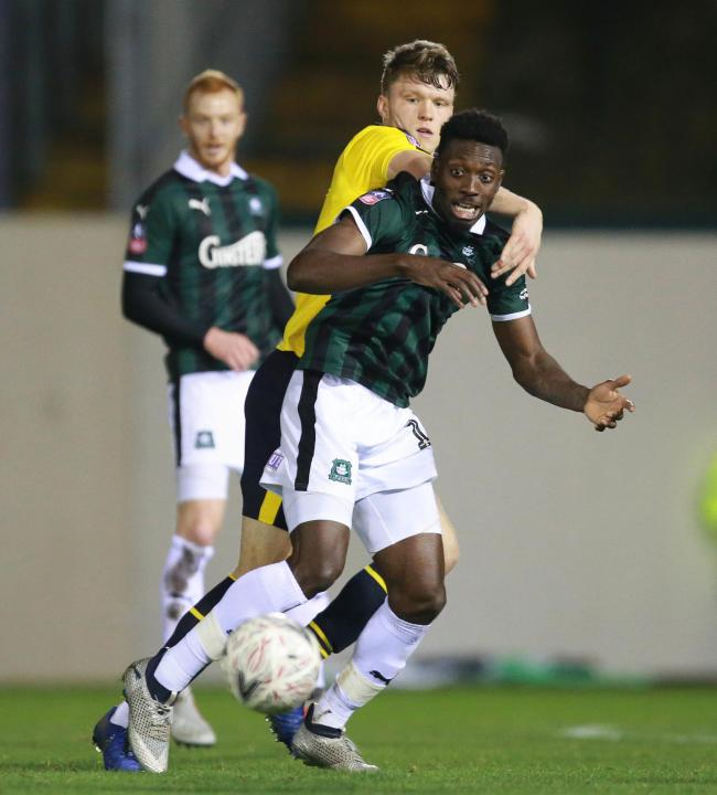 Freddie Ladapo of Plymouth Argyle holds off Rob Dickie of Oxford United during the Sky Bet League 1 match between Plymouth Argyle and Oxford United on Saturday 1st December 2018 at  Home Park, Plymouth, Devon - Photo: Dave Rowntree/PPAUK.