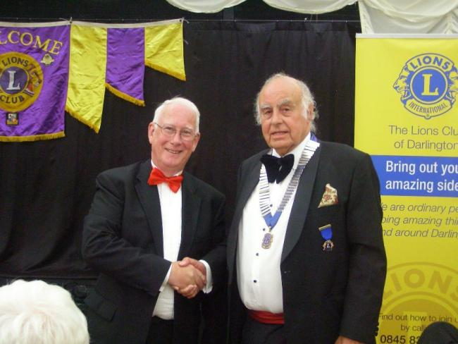 Lion Tony Gent who has acted as the club president for the past twelve months handed over the chain of office to Lion Neil Anderson