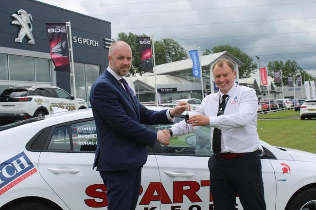 Craig hands over the keys for the electric car to Francis as part of their unique deal