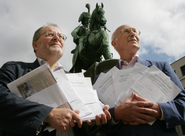 DEPTH OF FEELING: Armfuls of petitions containing  signatures against moving Lord Londonderry's statue in Durham Market Place, were handed in by Dr John Charters, chairman of the City of Durham Trust, left, and Dr Douglas Pocock, honorary secretary