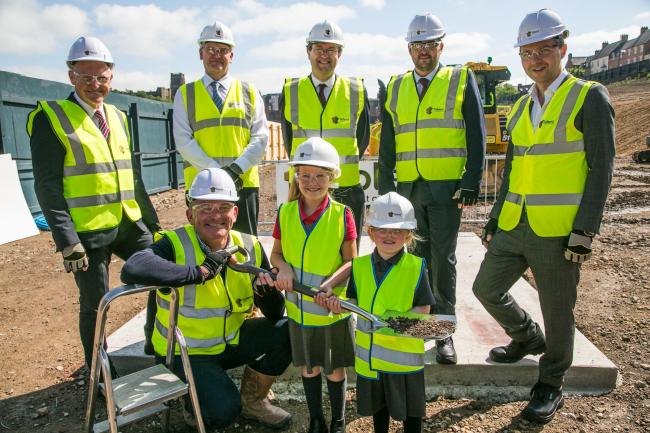 Schoolgirls Alexandra Chilton and Halle Robson breaking the ground at Milburngate