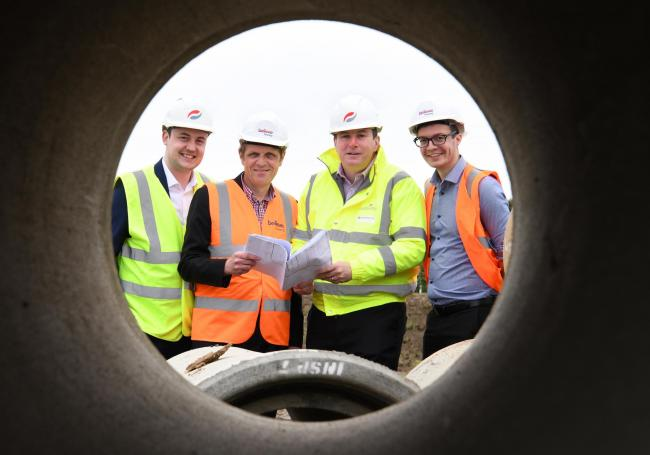 From left, are Jake Robson, Alan Smith, Sean Egan and Tom Winter examining the plans