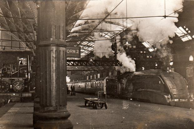 A very unusual view of Darlington's Bank Top station featuring one of the first Class A4 streamlined locomotives Silver Fox heading south (you can just make out its number, 2512 on the front). It entered service in 1935. On the left is Locomotion No 1