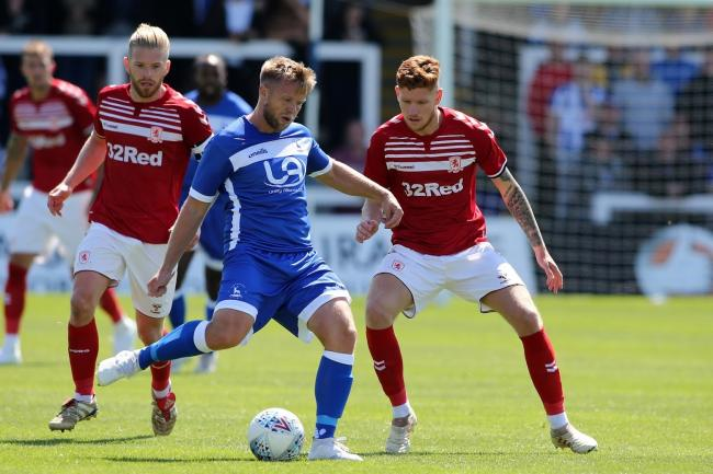 Adam Clayton watches Connor Malley close down Nicky Featherstone during Middlesbrough's friendly win over Hartlepool