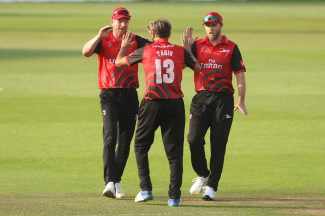Durham's Paul Collingwood and Nathan Rimmington congratulate Imran Tahir after he claimed Jack Leaning's wicket during the Vitality T20 Blast match between Durham Jets and Yorkshire Viking