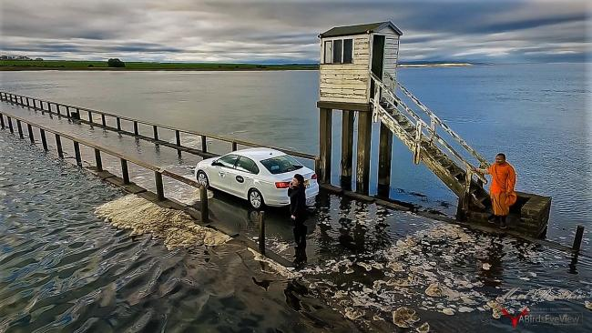 An Uber gets caught by the rising tide at the Holy Island causeway image: Mark Bradshaw.