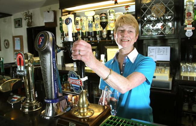 Poppy Harris, pictured in 2011 as landlady of the Half Moon at Barton 				Picture: RICHARD DOUGHTY