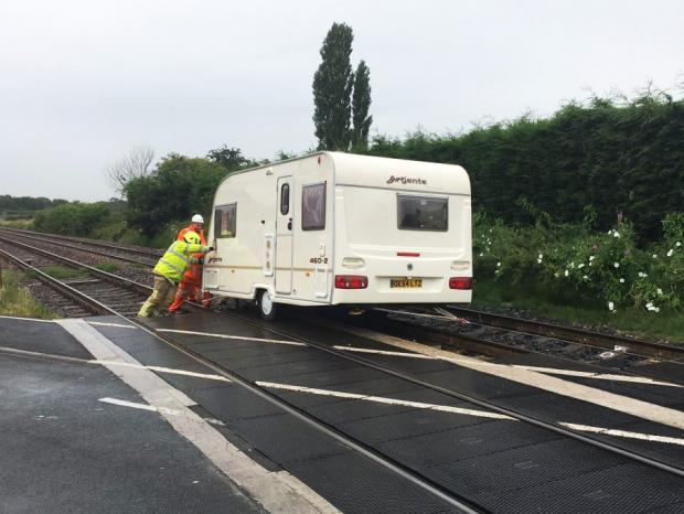 The Northern Echo: The caravan is pushed off the railway tracks at Haxby. Picture: Fire station manager Bob Hoskins