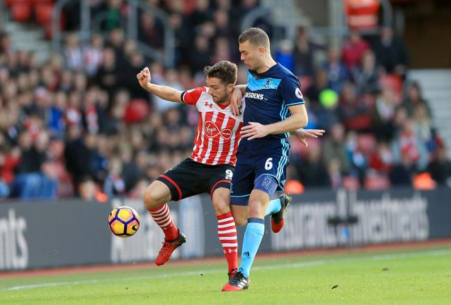 Southampton's Jay Rodriguez (left) and Middlesbrough's Ben Gibson. Picture: PA