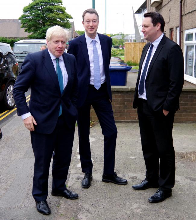 Simon Clarke and Ben Houchen welcome Boris Johnson at the Conservative Office in Rectory Lane Guisborough	 Picture: PA
