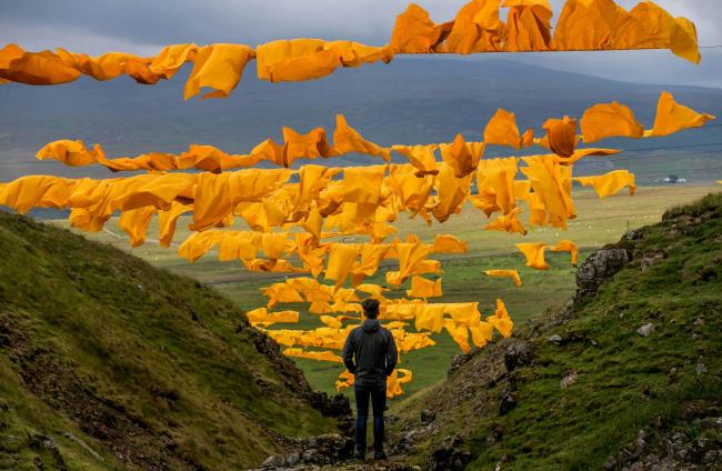 The saffron yellow sails of Hush in upper Teesdale, with the full majesty of the dale behind. Picture: SARAH CALDECOTT