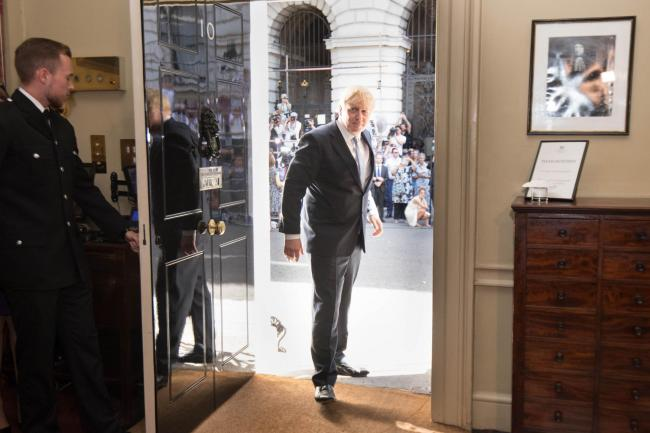 New Prime Minister Boris Johnson is welcomed into 10 Downing Street by staff after seeing Queen Elizabeth II and accepting her invitation to become Prime Minister and form a new government. Picture: Stefan Rousseau/PA Wire
