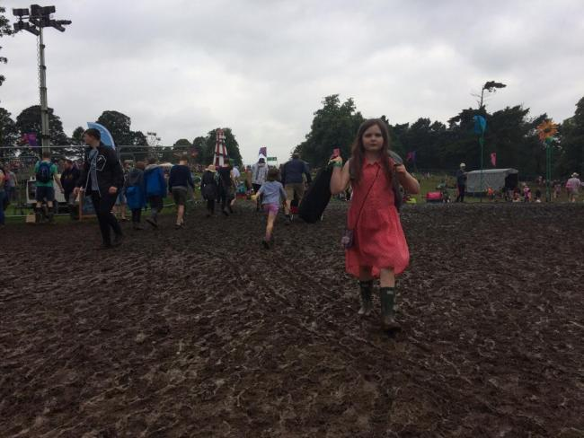 A young festival-goer walks near the main stage at the Deer Shed Festival 2019