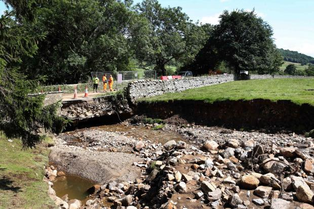 The Northern Echo: The damaged bridge on the B6270 over Cogden Beck near Grinton Picture: RICHARD DOUGHTY