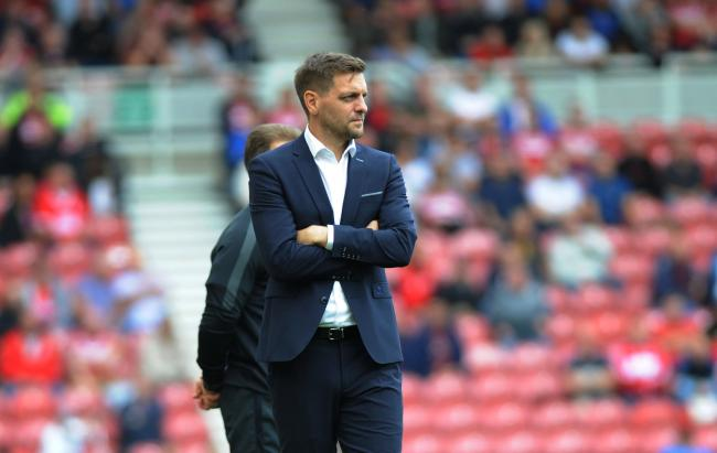 Middlesbrough head coach Jonathan Woodgate watches on during his side's 1-0 home defeat to Brentford