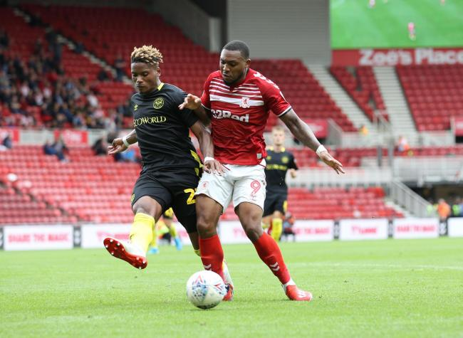 Britt Assombalonga holds off his opponent during Middlesbrough's 1-0 defeat