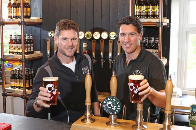 Rob Theakston, left, and Jo Theakston, right, raise a pint to Black Sheep Brewery's World Beer Award success