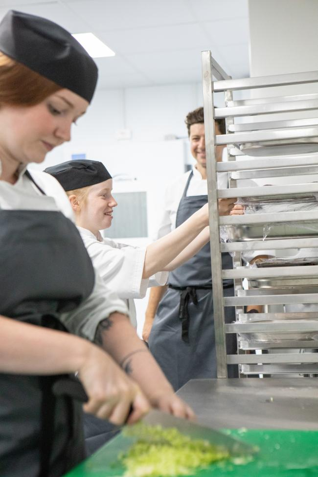 Members of The Auckland Project Catering Team at work in the central kitchen