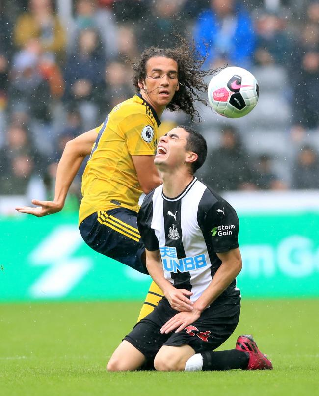 Miguel Almiron finds himself on the floor during Newcastle United's opening-weekend defeat to Arsenal. The Paraguayan has struggled in the opening two games of the season (Picture: Owen Humphreys/PA Wire)