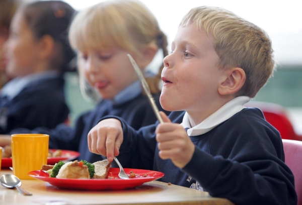 HOT TOPIC: Kirk Merrington pupils Jack Clarey and Sophie Golightly, both six, tuck in to their school   dinner yesterday