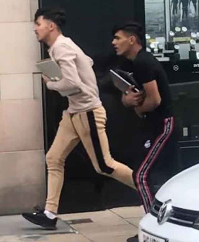 Two men flee from an Apple store.  Picture: NORTH YORKSHIRE POLICE