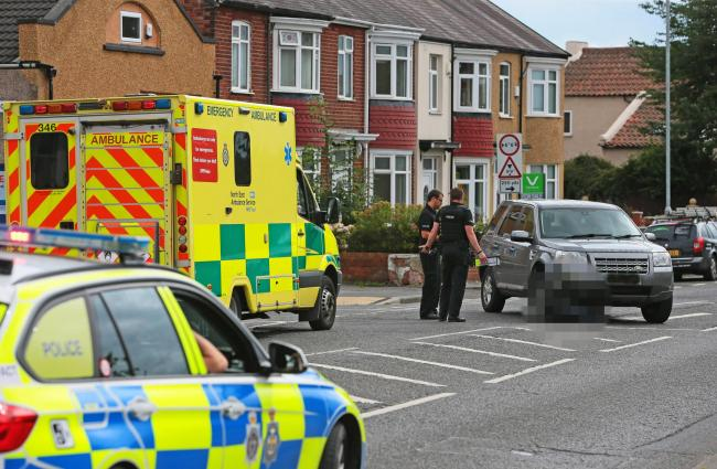 The scene on Neasham Road, in Darlington, where a man in a wheelchair has been struck by a car