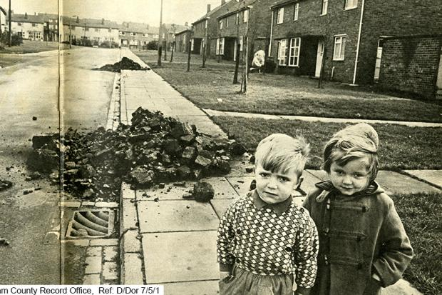 Youngsters pictured in front of kerbside coal deliveries in Peterlee in the 1950s. Picture: Durham County Record Office D/Dor 7/5/1