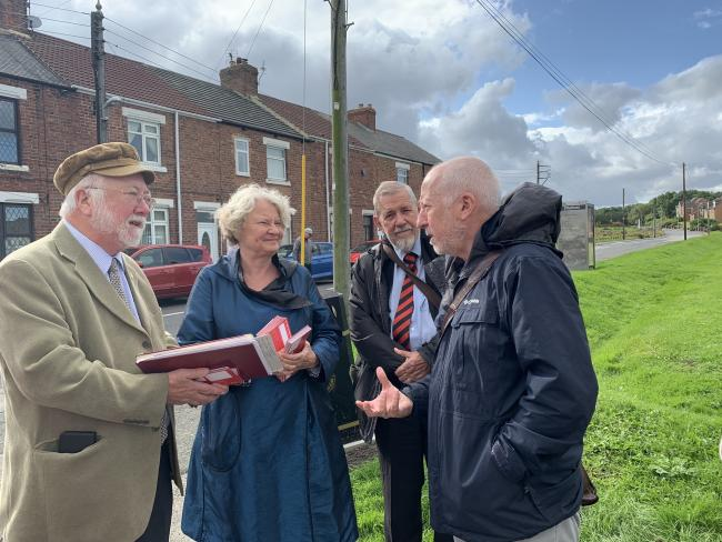 Andy McDonald, Shadow Secretary of State for Public Transport, left, talks to residents about buses in Coundon with Helen Goodman MP