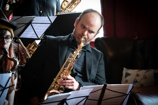 Festival Director Paul Edis gets the event underway with the Early Bird Big Band. Pictures: Chris Barron