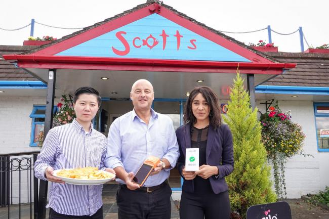 Tony Webster, owner of Scotts fish and chip shop, centre, with JGOO's head of operations Xiaowen Li, left, and senior sales executive Nafisa Meme