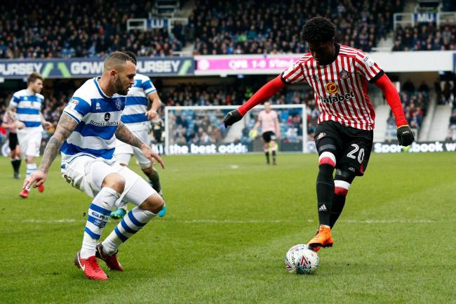 Sunderland's Josh Maja takes on Queens Park Rangers Joel Lynch - who has now moved to Wearside