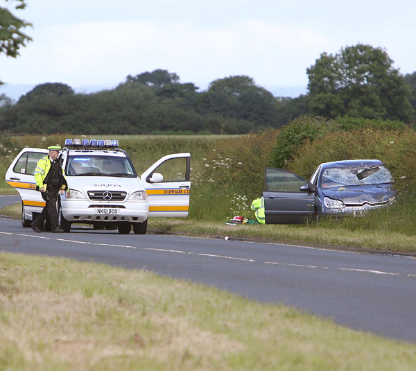 CRASH SITE: Police at the scene of the fatal accident on the A167 near Croft involving a car and two cyclists