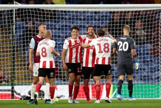 Sunderland's players celebrate after Will Grigg's equaliser in their 3-1 win at Burnley (Picture: Nick Potts/PA Wire)