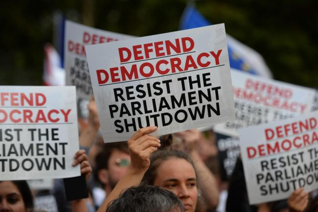 Protesters from Another Europe is Possible outside the Houses of Parliament, London, to demonstrate against Prime Minister Boris Johnson temporarily closing down the Commons. Picture: Kirsty O'Connor/PA Wire