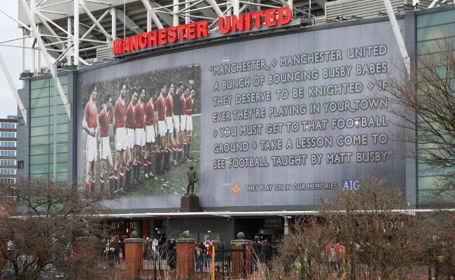 The Sir Matt Busby statue and banner outside Old Trafford in memory of the Munich air crash