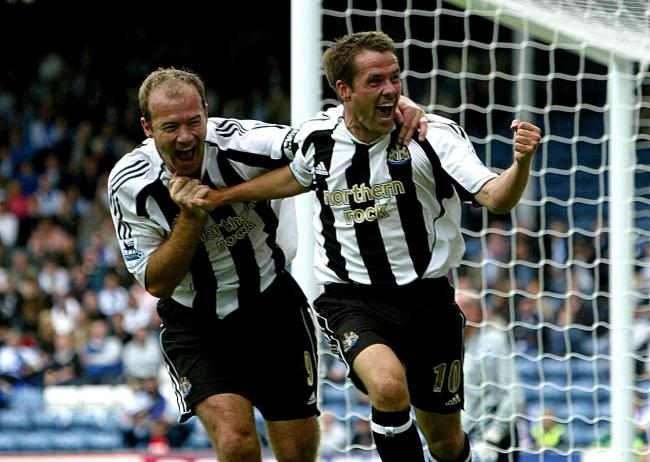 Newcastle United's Michael Owen celebrates with team-mate Alan Shearer (L) after scoring the first goal for his club, and the second goal against Blackburn Rovers..
