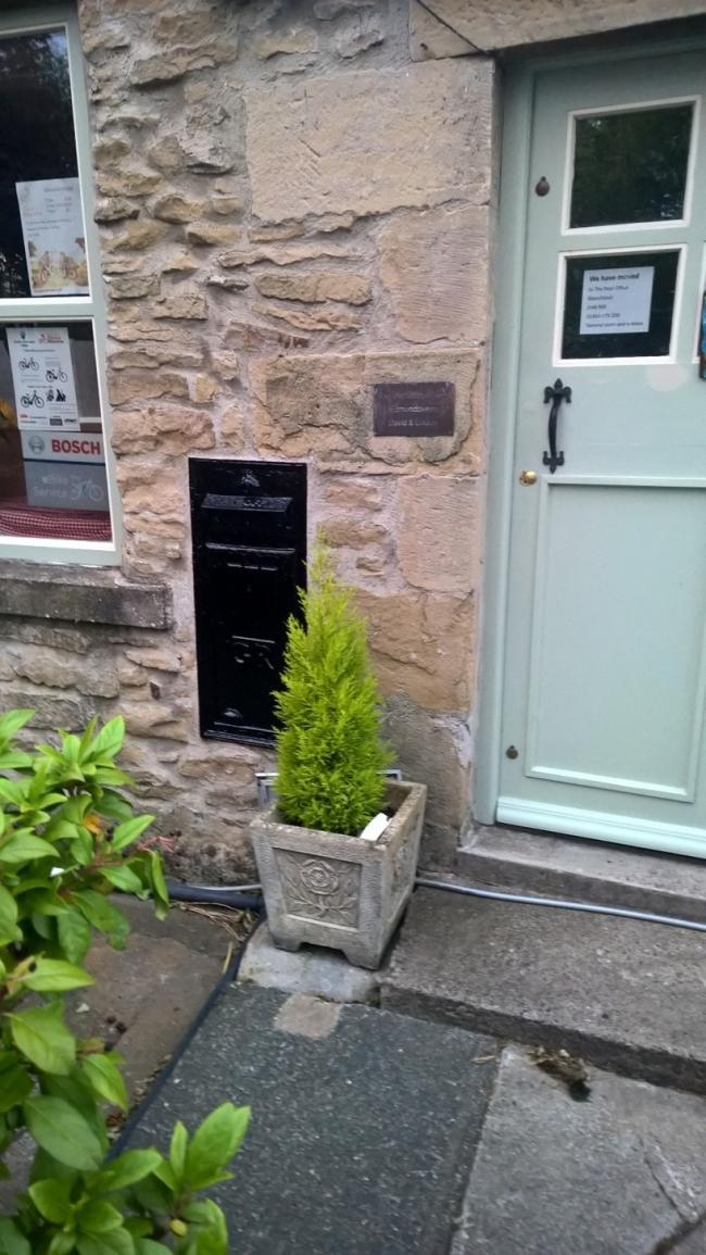 Edmundbyers Post box painted black and sealed shut