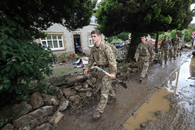 Soldiers from 2 Yorks arrive in Grinton, North Yorkshire to help out with flood damage, after parts of the region had up to 82.2mm of rain in 24 hours on Tuesday. PRESS ASSOCIATION Photo. Picture date: Wednesday July 31, 2019. See PA story WEATHER Rain. P