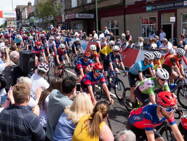 Consett Cycle Festival 2019, incorporating Tour of the Reservoir Cycle Race. Competitors parade past hundreds of racing fans and spectators in Front Street, Consett, to start the 188 mile men's race. Picture by Dave Foster