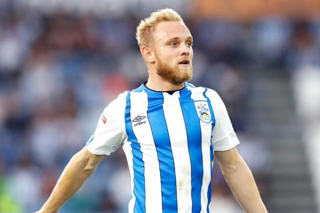 Alex Pritchard has completed his move to Sunderland after being released by Huddersfield Town.
