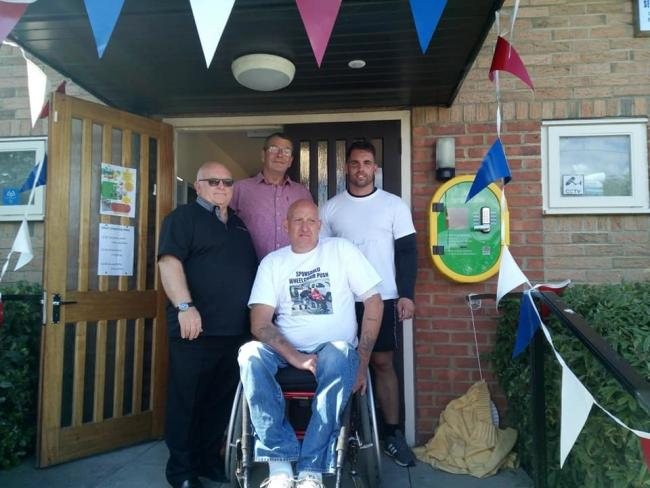 A defibrillator has been installed at Witton Park Village Hall, with help from John McLeod and Paul Hauxwell who did a sponsored wheelchair push