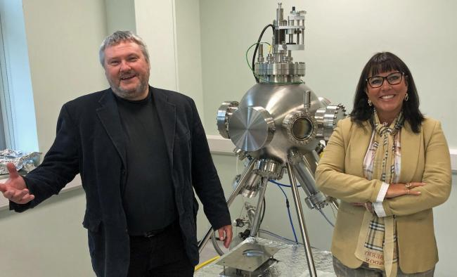 Deborah McGargle with Evince CEO Gareth Taylor and a new metal deposition system the company has recently bought