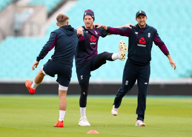 Ben Stokes (centre) and Joe Root during England's nets session at The Oval yesterday