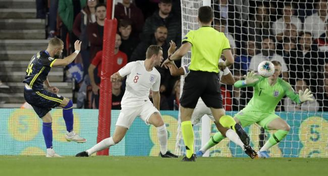 Valon Berisha curls home Kosovo's second goal in their 5-3 defeat to England at Southampton's St Mary's Stadium