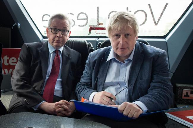 Michael Gove and Boris Johnson on the Vote Leave campaign bus. Picture: PA