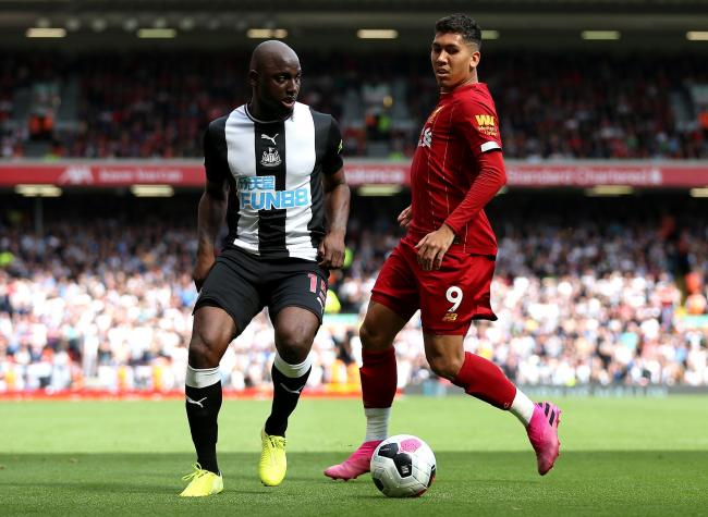 Newcastle United's Jetro Willems (left) and Liverpool's Roberto Firmino during the Premier League match at Anfield, Liverpool. PA Photo. Picture date: Saturday September 14, 2019. See PA story SOCCER Liverpool. Photo credit should read: Nigel Fre