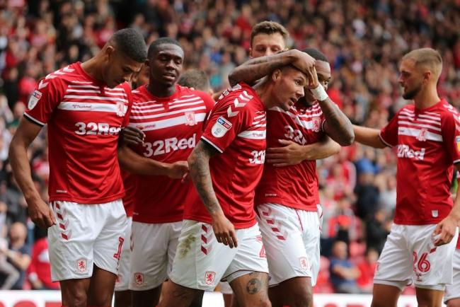Marvin Johnson is mobbed by his team-mates after scoring Middlesbrough's winner against Reading