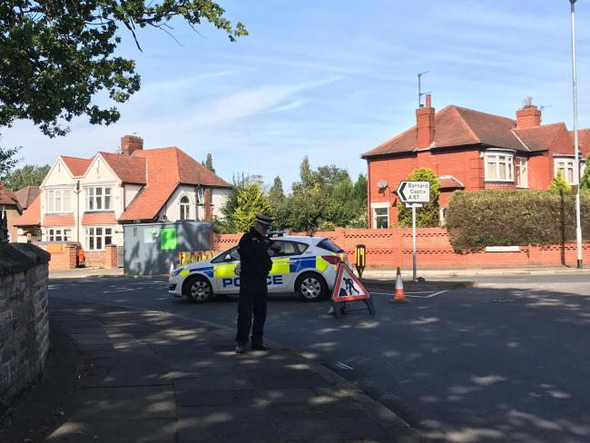 Paramedics giving CPR to cyclist after incident in Darlington